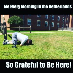 man kissing the ground in gratitude