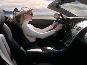 woman in luxury car Dutch reaction