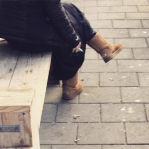 Woman wearing Ugg boots and smoking in Amsterdam