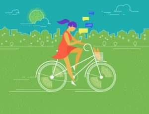 Girl texting while cycling on an Amsterdam Bike lane