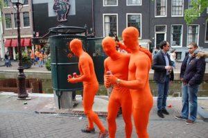 men fully covered in orange