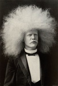 white man with an afro