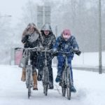 cyclists in the snow