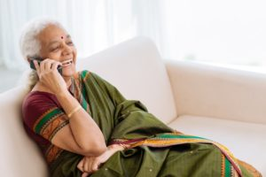 Older Indian Woman on phone laughiing