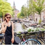 Instagram Influencer in Amsterdam Posing by a canal