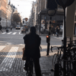 cyclist in Amsterdam stopping at red traffic light