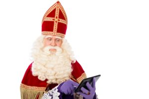 Sinterklaas reading an Ipad
