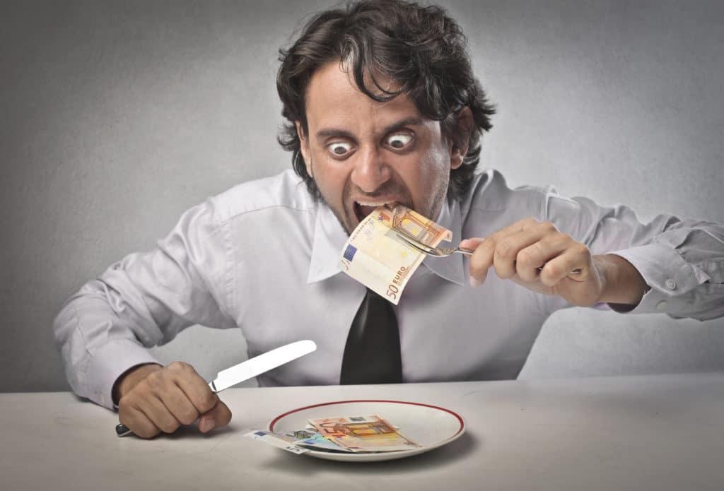 man eating money adobestockphoto